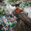 A boy works at a plastic bottle recycling centre by the river Buriganga in Dhaka. Photo: Andrew Bhiraj/Reuters