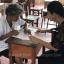 Prapasri Paowal, head of the the Non-Formal and Informal Education Office in tambon Kuan Pring of Trang, gives exam instructions to her oldest student, Grandma Khlong Faikhao. Photo: Methee Muangkaew/Bangkok Post