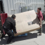 YouTuber Ben Sullins (right) delivers a brand new couch to the Tesla factory in Fremont, California on May 1, 2018. Photo: YouTube/Teslanomics by Ben Sullins