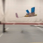 The ion-drive plane takes flight at MIT's indoor running track. Photo: Nature / YouTube