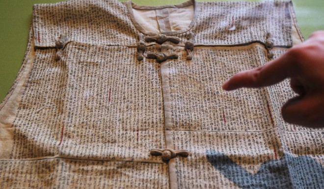Cheating is by no means a new phenomenon. This is a replica of a linen vest overwritten with notes for a civil service exams in China's Qing dynasty (1644-1912)