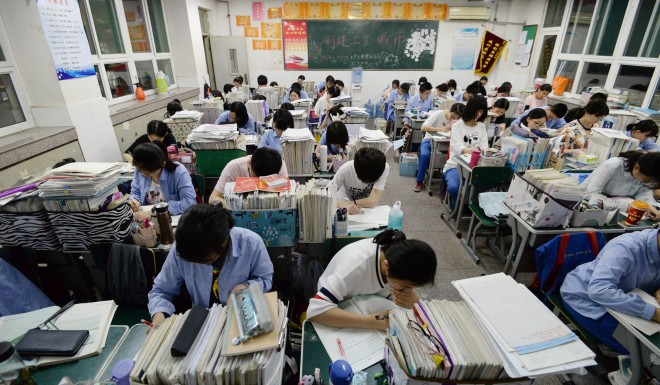 Chinese high school students study late at night for the annual college entrance examinations in Handan, Hebei Province.