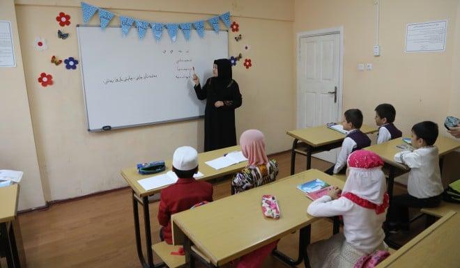 Hanipe Abdurxit teaches Uygur at the Tangnuri language center in Istanbul.