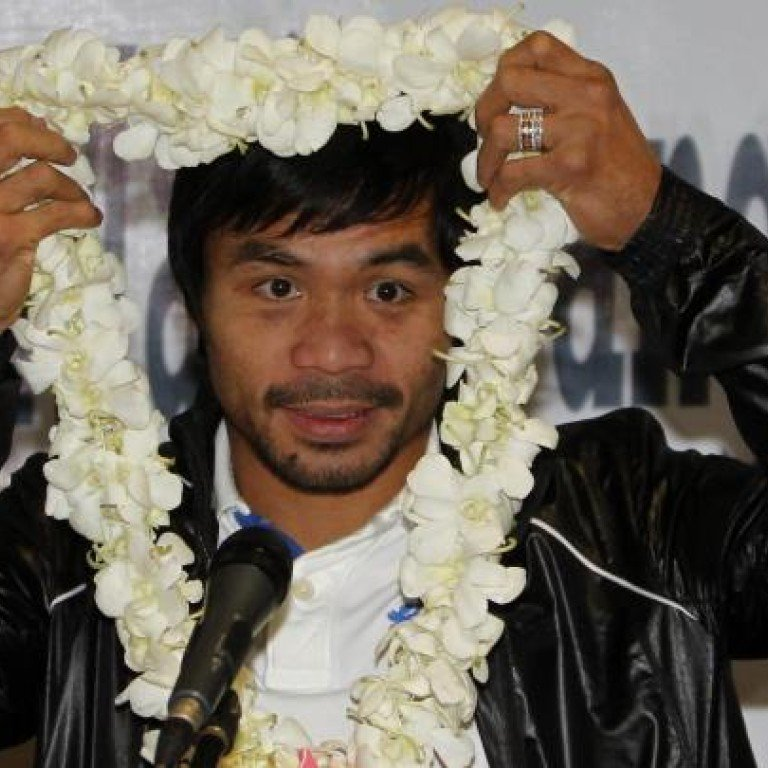 Manny Pacquiao aides accused of attacking photographer
