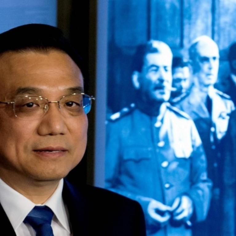 Premier Li Keqiang, in Potsdam, warns Japan on postwar vows