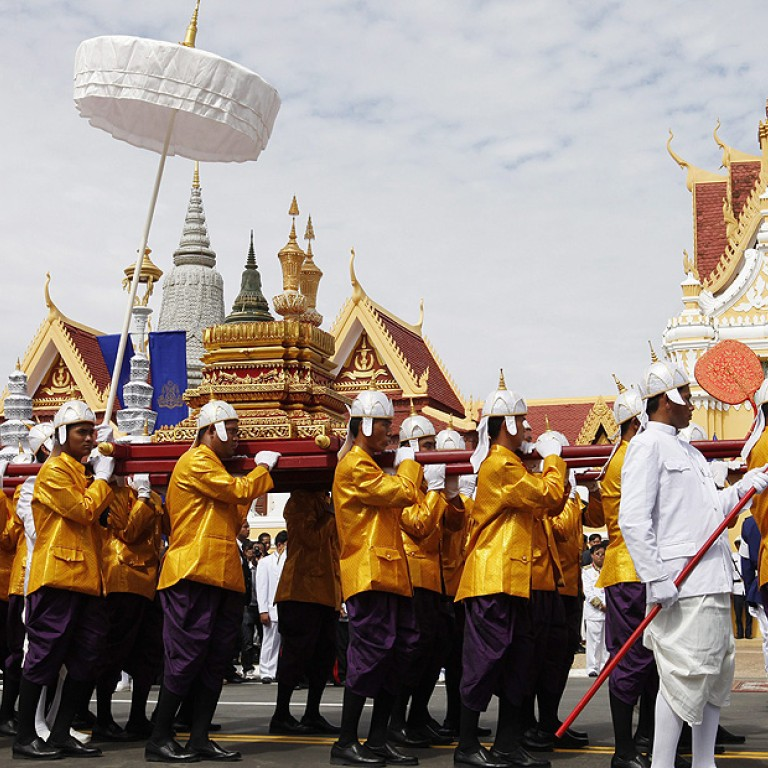 d7be0b5c9b12 Cambodian officials carry urns containing ashes of former King Norodom  Sihanouk during a parade in Phnom