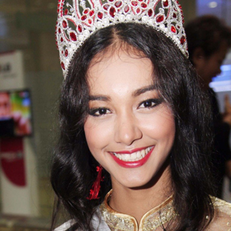 Dethroned Myanmese beauty queen flees with US$100,000 crown after