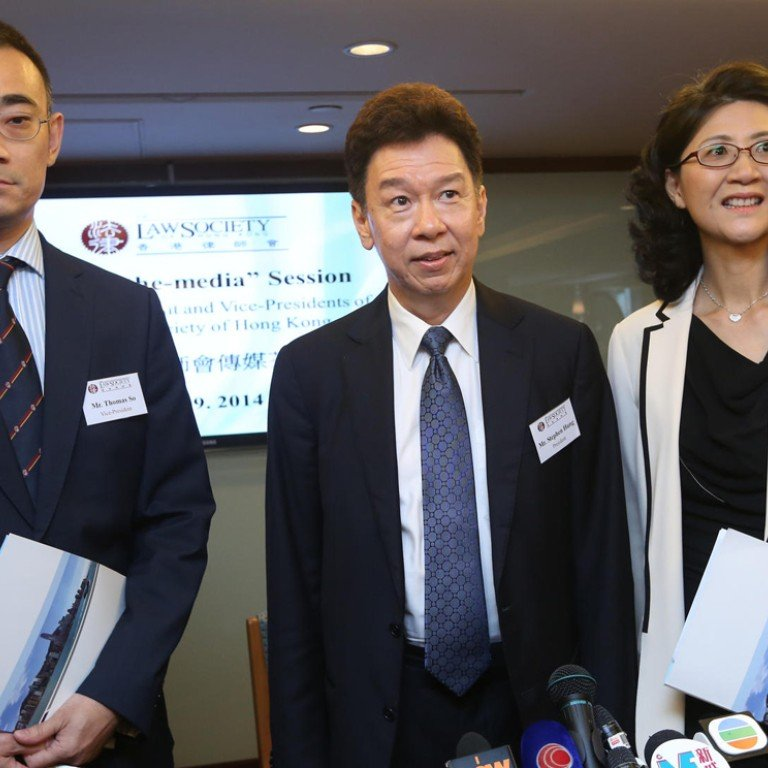 23b2ce1b4 Law Society president Stephen Hung (centre) with his deputies Thomas So and  Melissa Pang