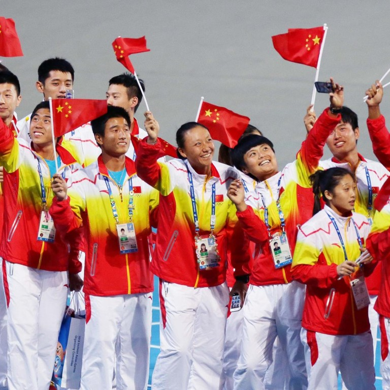 Chinese athletes celebrate the nation's victory after it came out on top in  the Asian Games