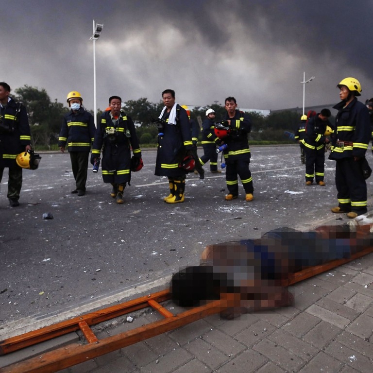 Firefighters briefly pulled out of site of Tianjin warehouse