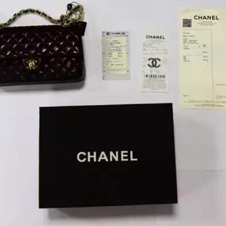 e8aaf435acf0 A fake black lambskin Chanel bag being offered for 6,340 yuan at a Chinese  wholesale market