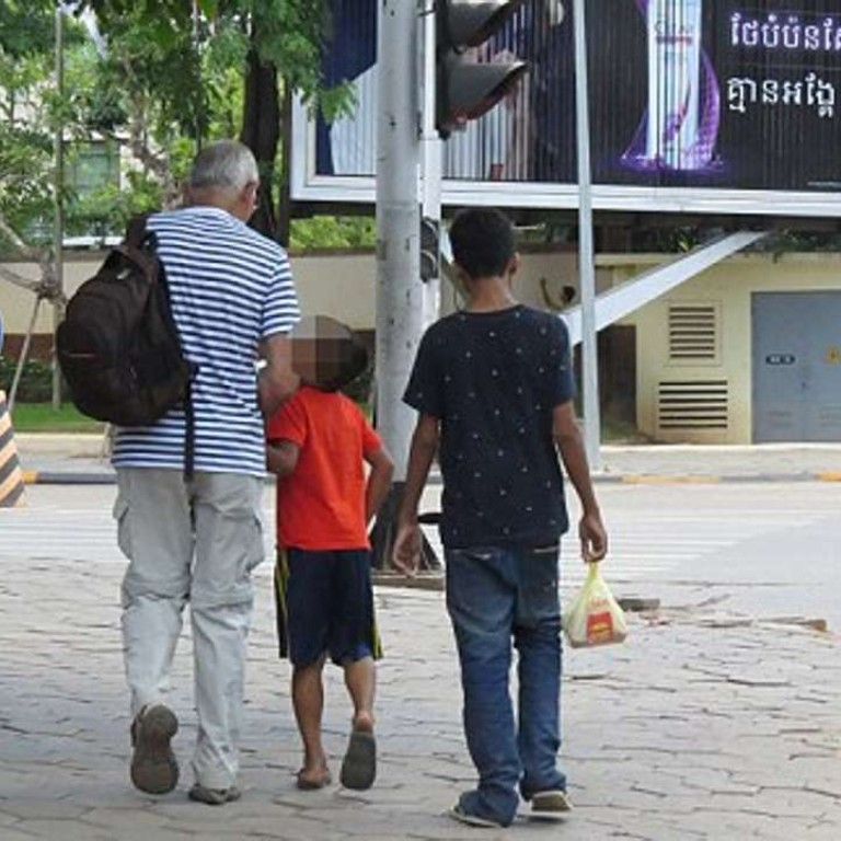 878e467217 Roy Sheppard was pictured with the two boys while under surveillance by  investigators from an NGO