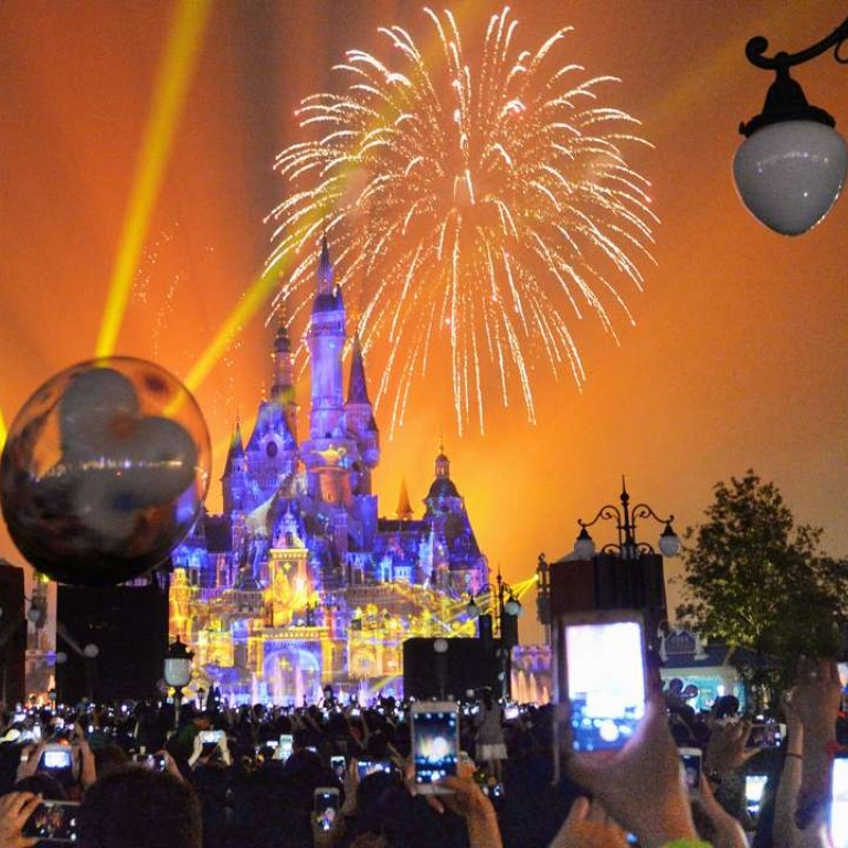 Fireworks light up Shanghai Disneyland as it opened on June 16. But visitor numbers are far from bright so far. Photo: Kyodo