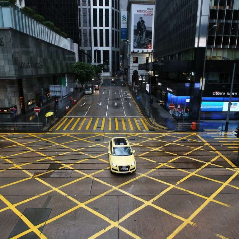 Empty streets in Central commercial area during morning peak hour in Hong Kong. Photo: David Wong