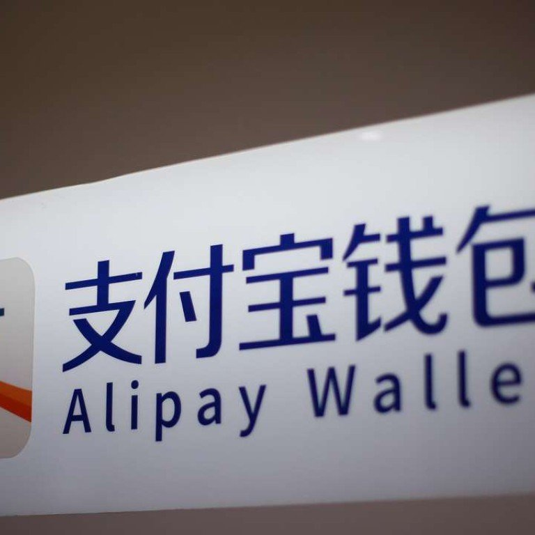 An Alipay logo is seen at a train station in Shanghai. Photo: Reuters