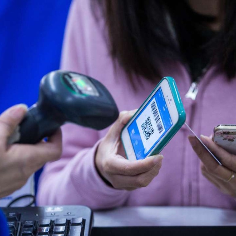 Mobile payments in China surged 52 per cent to 9.4 trillion yuan in the second quarter of this year from the same period of 2015, according to iResearch. Photo: Imaginechina