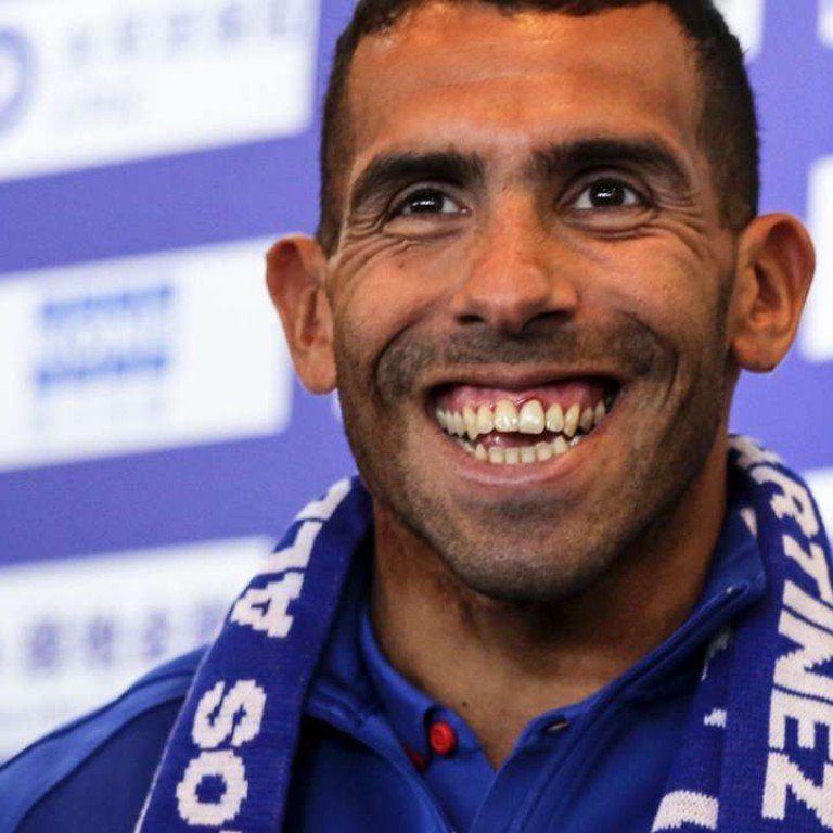 4d611bc2d06 Argentine striker Carlos Tevez smiles during a press conference in Shanghai  on January 21