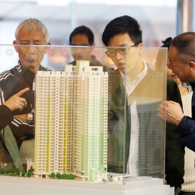 Housing prices top list of priorities for Hong Kong's next chief