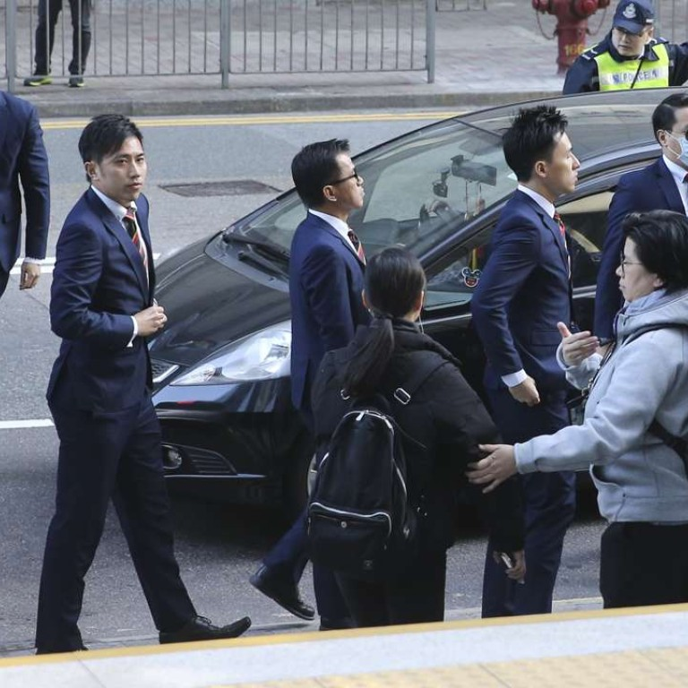 Hong Kong sentences 7 policemen to two years jail for