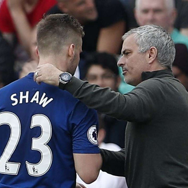 51579a4b1 Manchester United s Luke Shaw is congratulated by manager Jose Mourinho as  he is substituted. Photo