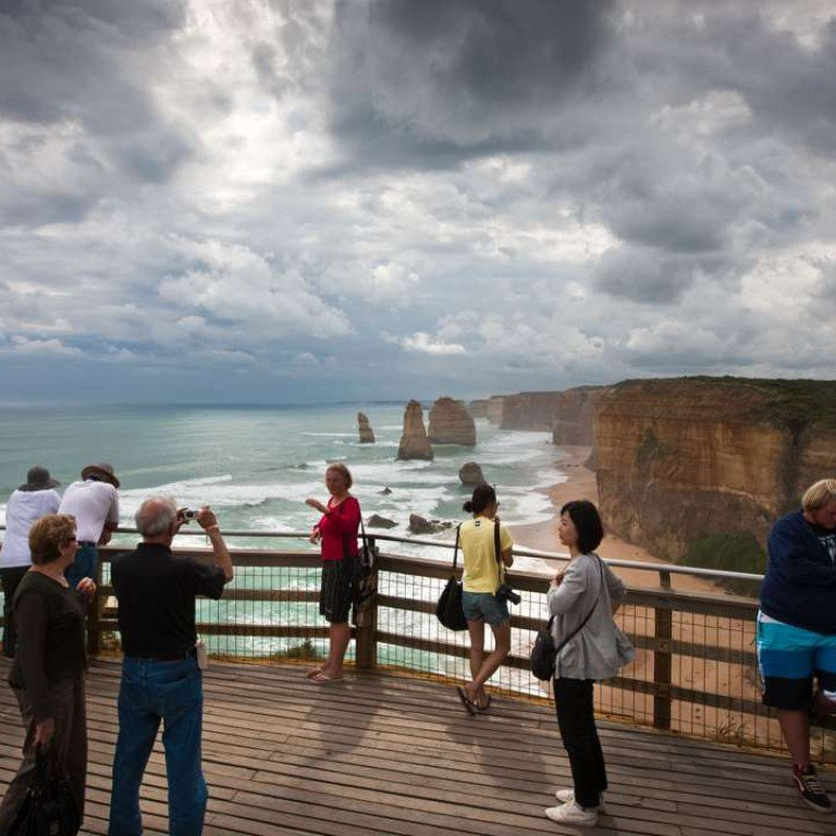 ebb6e10fa Tourists on a board walk at the Twelve Apostles in South West Victoria
