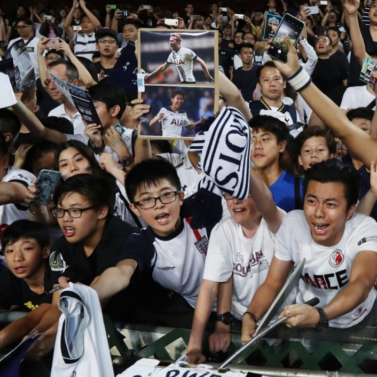 25961610c Tottenham Hotspur fans cheer their team in Hong Kong. Photo  SCMP   Nora Tam