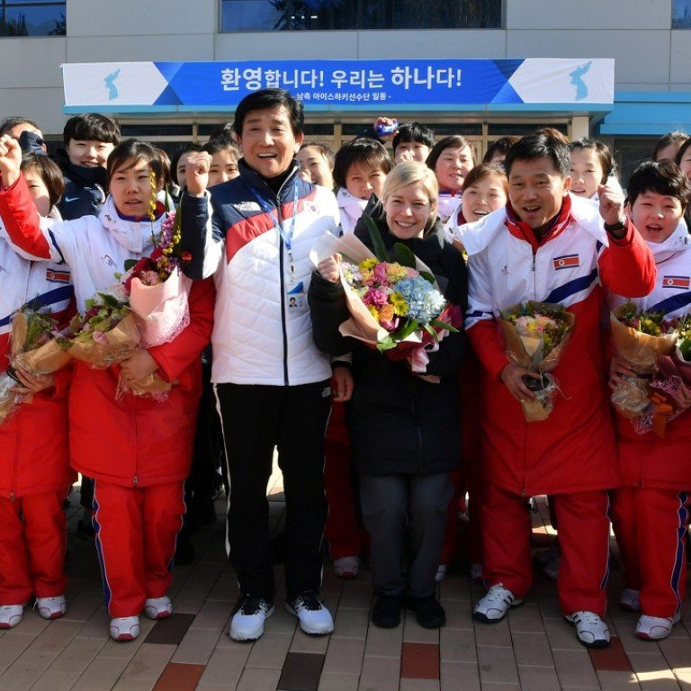North Korean hockey players cross the border to join up with