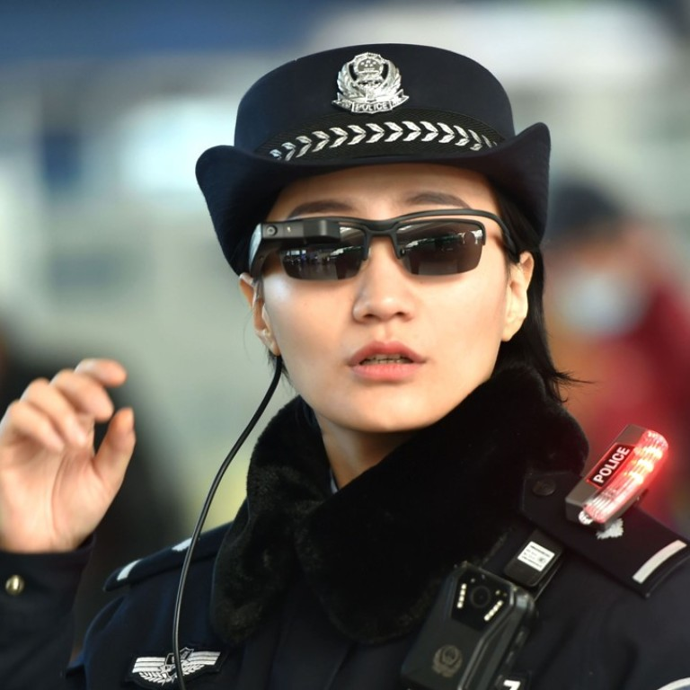 A police officer using the facial recognition glasses. Photo: AFP