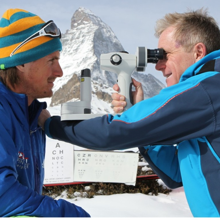 cf3447f5bea1f Nick Dash checks the eyes of Austrian climber Guido Unterwurzacher in front  of the Matterhorn