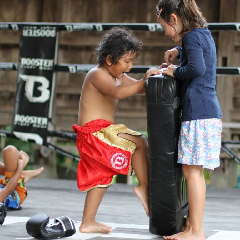 1ba6b52ea Children help each other learn Muay Thai at Frances and Boom Watthanaya s  gym in northeast Thailand