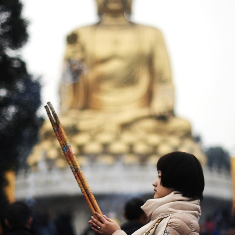 China orders crackdown on large outdoor religious statues to