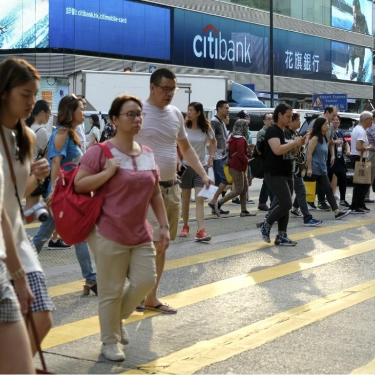 Pay gap: Hong Kong women earn more than men before 20 but only half