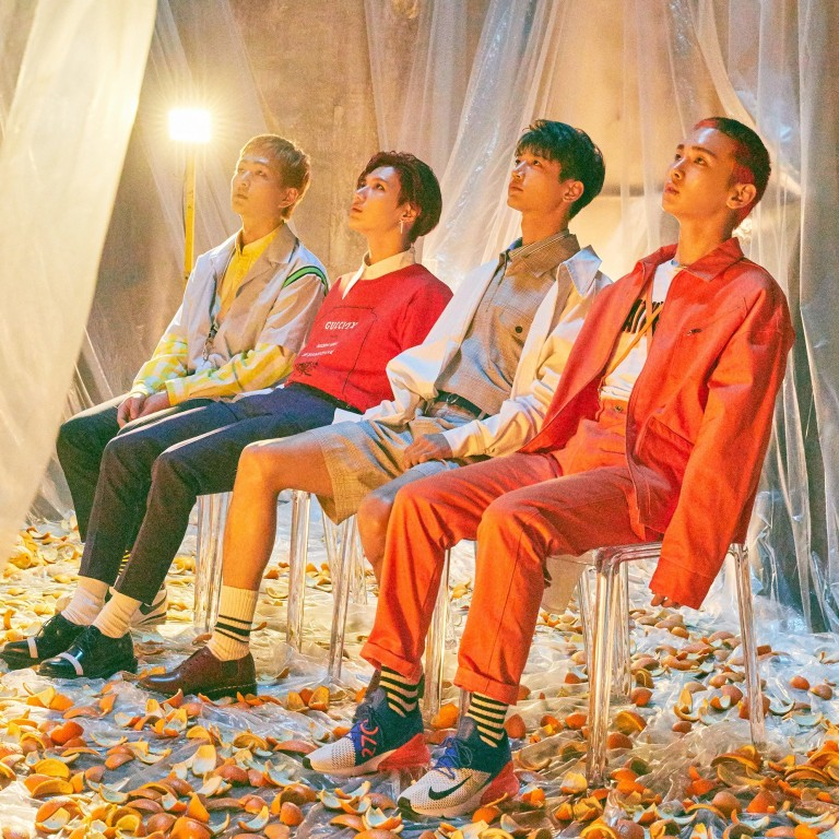 K-pop stars SHINee release new album in three parts to