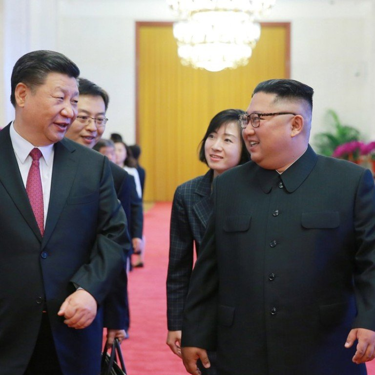 4b49fc71 Xi Jinping pledged to improve economic ties to North Korea during his  meeting with Kim Jong