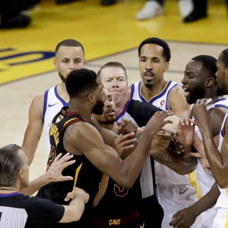 cee01885d618 An official tries to separate Tristan Thompson and Draymond Green during  overtime of game one of