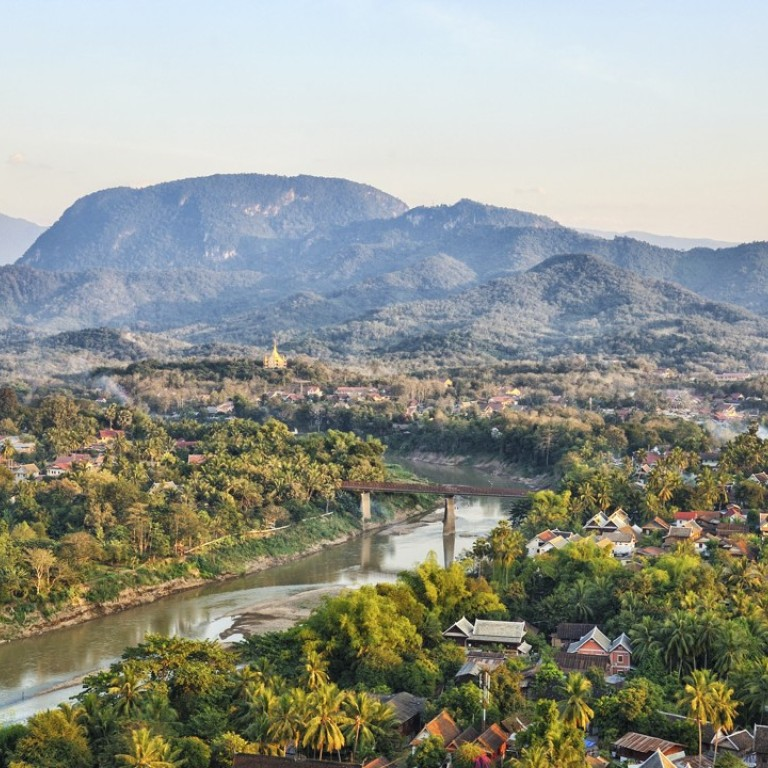 Nam Khan River and Luang Prabang. Laos is facing increasing tourist numbers from the upcoming Laos-China Railway. Photo: Alamy