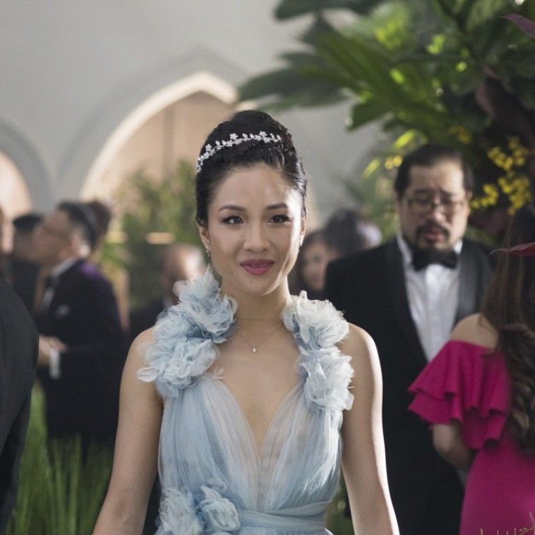 Crazy Rich Asians is about a young woman (Constance Wu) being initiated into Singapore high society. Photo: AP