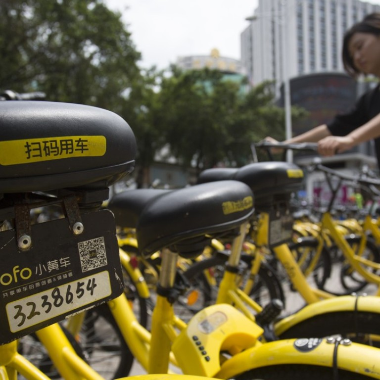 Chinese Bike Sharing Firms Pull 3 000 Bikes Out Of Rivers Vow To