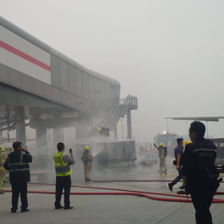 Man, 21, arrested after cargo pallet catches fire at Hong