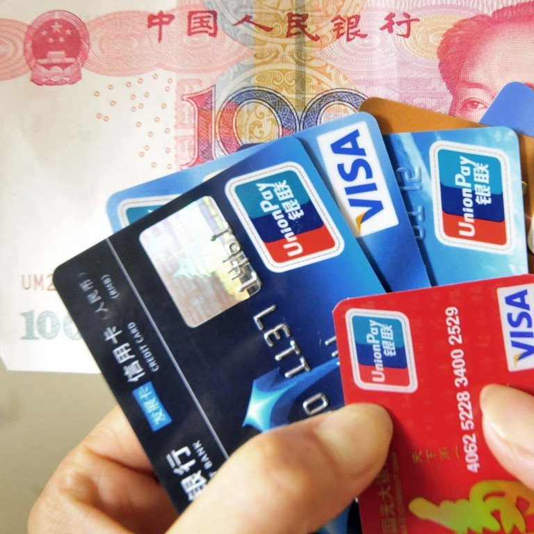 China's central bank denies delaying Mastercard and Visa access to