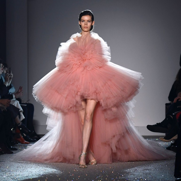 6295f3172 A model presents a pink gown by Giambattista Valli during the 2019 spring/summer  haute