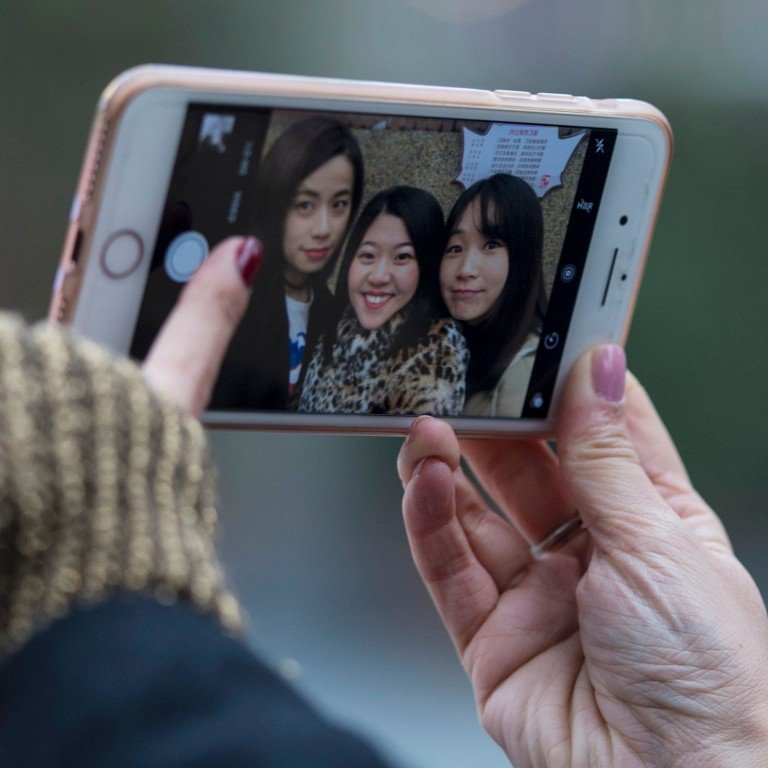 The Timeless mobile app, created by Emma Yang, uses an artificial intelligence-powered facial recognition system to help Alzheimer's patients identify people in photos. Photo: Agence France-Presse