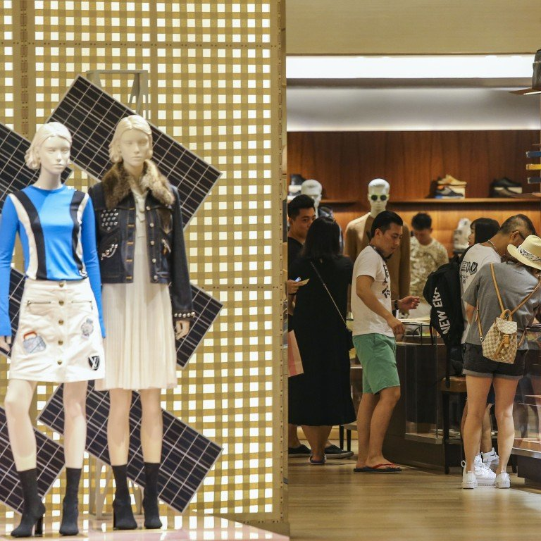 0318203d1b3 Chinese tourists at a luxury goods store in Hong Kong. While it is too early