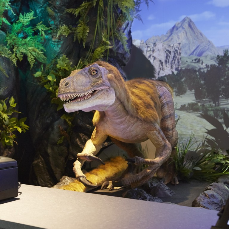Henn-na Tokyo hotel's dinosaur at the reception desk is programmed to speak the language of guests when they check in.