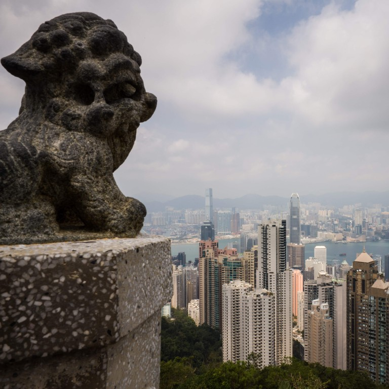 Hong Kong law requires that brokerages and other financial firms report large and suspicious transactions to the Joint Financial Intelligence Unit. Photo: AFP