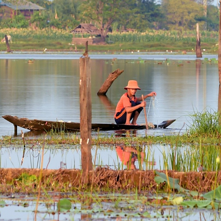 A Cambodian fisherman lays his nets out on Ta Mok Lake in Anlong Veng, Cambodia. Photo: AFP
