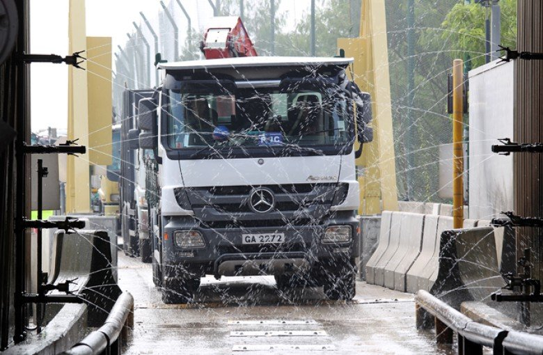 A collection lorry passes through the facility's vehicle-wash system.