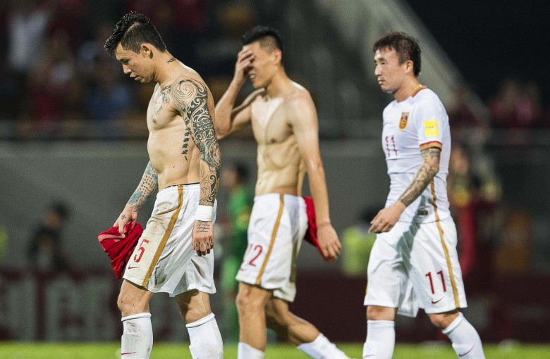 Cover up! Chinese soccer players are facing a tattoo ban