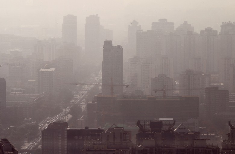 Face masks on: pollution is back in Beijing