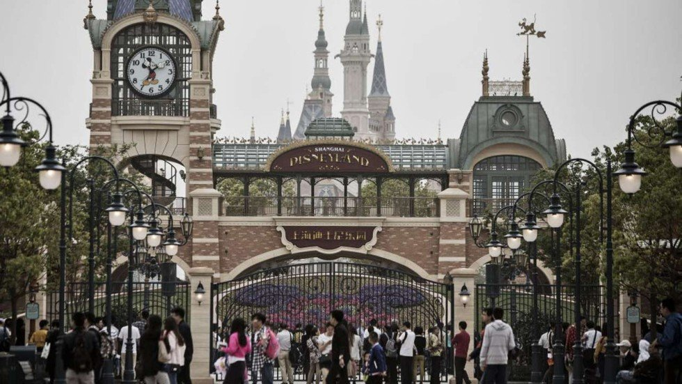 Visitors pass the gates to the Shanghai Disney at the trial run. Only ...